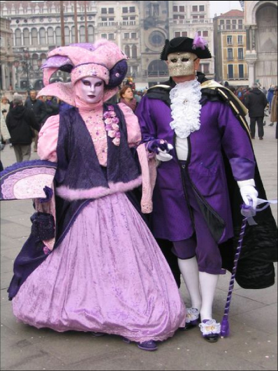 Purple costumes and Venetian Masks at Carnival in Venice Italy